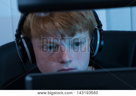 Close-up Of A Boy Working On Computer
