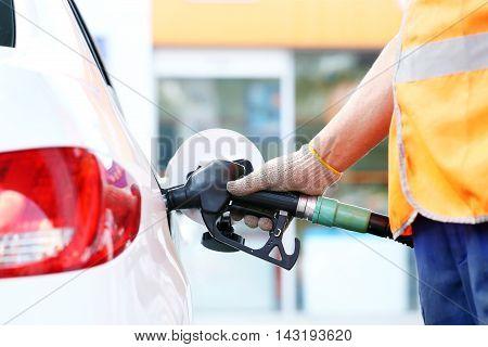 Refuel white modern car with a petrol