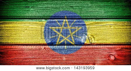flag of Ethiopia painted on old grungy wooden background: 3d illustration