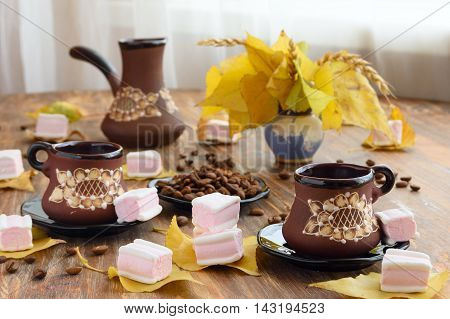 table setting in autumn style with coffee and marshmallows