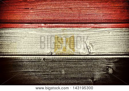 flag of Egypt painted on old grungy wooden background: 3d illustration