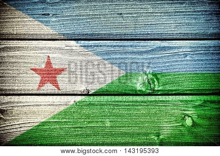 Flag of Djibouti painted on old grungy wooden background: 3d illustration