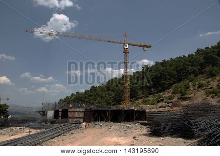 tower crane load carrying construction of buildings under cloud