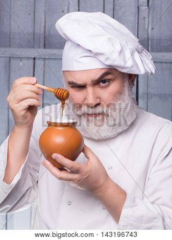 Cook Tasting Honey