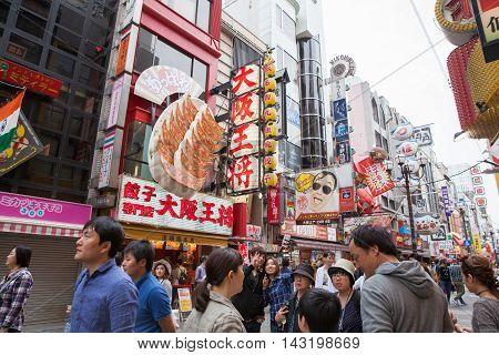 OSAKA JAPAN - Apr 24 2016 : People walking in the Dotonburi Osaka. Dotonburi is one of the principal tourist destinations in Osaka Japan.