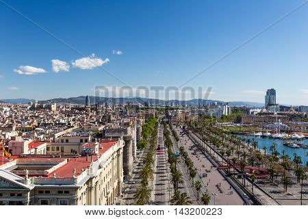 Barcelona cityscape. Aerial view of Port Vell marina and Barceloneta district.