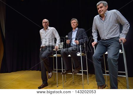 BUENOS AIRES ARGENTINA - NOV 10 2015: Mauricio Macri (C) presidential candidate with his advisor Marcos Pena (R) and Buenos Aires elected mayor Horacio Rodriguez Larreta (L) at a press conference.