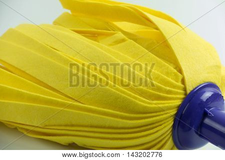Yellow mop on white background. cleaner floor