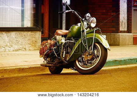 a classic motorcycle parked in the street
