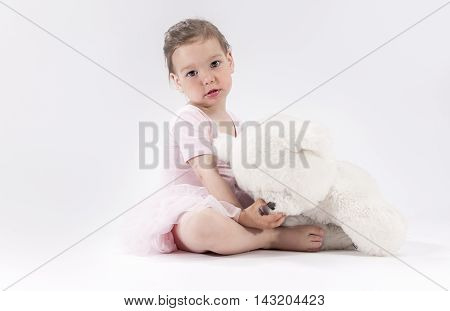 Natural Portrait of Cute Blond Caucasian Child With Positive Facial Expression. Holding Big Teddy Bear Toy. Horizontal Shot