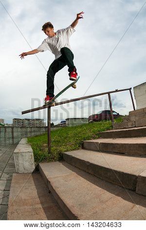 Zelenograd Russia - July 29 2009: Skateboarder Nikita Shumkov doing a backside crooked grind trick on a handrail in Zelenograd Russia.
