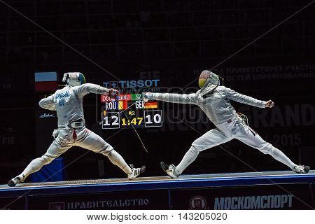 Moscow Russia - May 30 2015: Romania's Tiberiu Dolniceanu against Germany's Matyas Szabo in the finals of the men's individual event at the 2015 Moscow Sabre international fencing tournament.