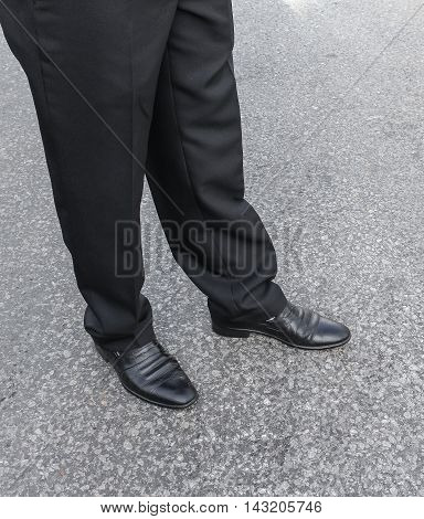 men pants and shoes. Legs of businessmen. businessman in black trousers and shoes