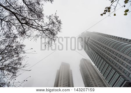 Buenos Aires Argentina - Jun 28 2016: Renoir Towers. Downtown skyscrapers under the fog upward view at the Puerto Madero.