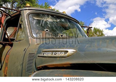 LAKE PARK, MINNESOTA, July 27, 15, 2016: The hood and bullet shattered window of a of the Ford F-350 pickup is a product of the Ford Motor Company located in Dearborn, Michigan started by Henry Ford and incorporated on June 16, 1903.