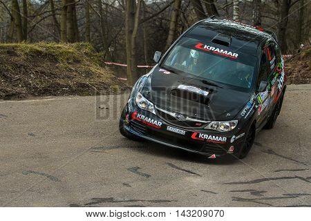 Moscow Russia - Apr 18 2015: Subaru Impreza driver Kramarenko Alexandr and co-driver Gergel Nikita during the Rally Masters Show 2015 at the Krylatskoye District.