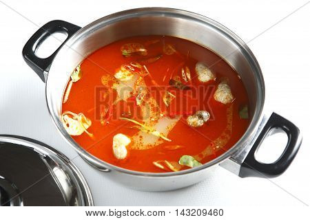 Hot pot of spicy tom yum in stew on white background