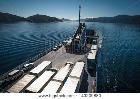 Ferry Loaded With Trucks And Cars Traveling From Wellington To Picton Via Marlborough Sounds, New Ze
