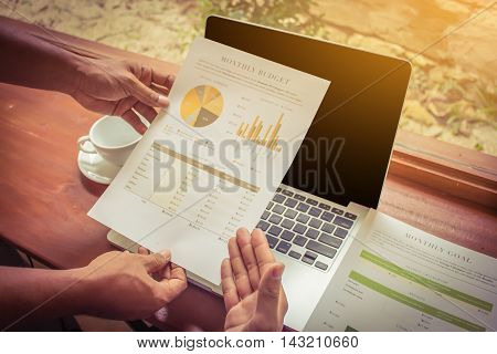 Business man and partner working at the office. analysis document and using laptop
