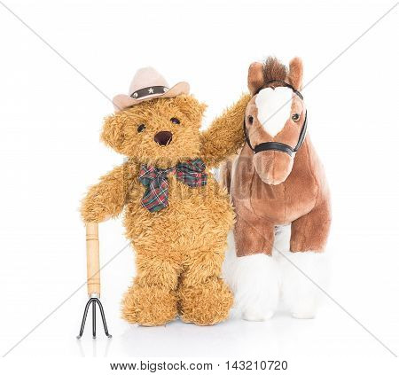 Teddy bear farmer with pitchfork and horse on white background