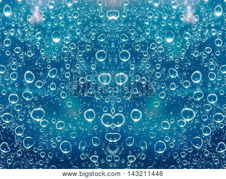 A close up shot of blue water droplets on a glass window pane