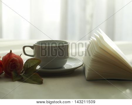 Fresh morning coffee on the bed, select focus.