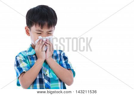 Child blow the nose. Asian boy using tissue to wipe snot from his nose and free form copy space. Child with allergy symptom. Isolated on white background. Studio shot.
