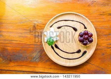 tart grapes cream cheese on the wood desk.