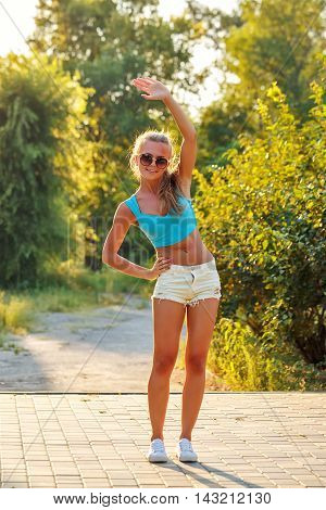Young slim woman doing sport slopes in the city park. outdoor sports.
