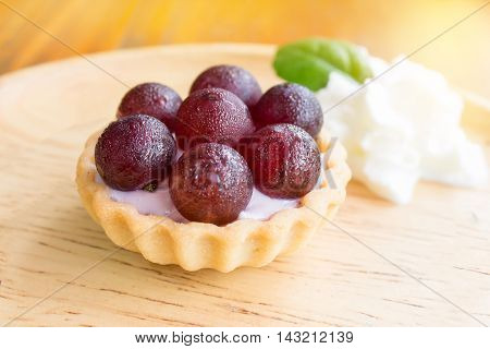 tart grapes cream cheese on wood desk.