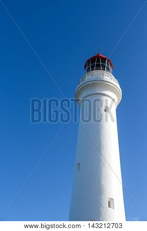 Split Point Lighthouse under beautiful blue sky at Aireys Inlet a small town on the Great Ocean Road Victoria Australia