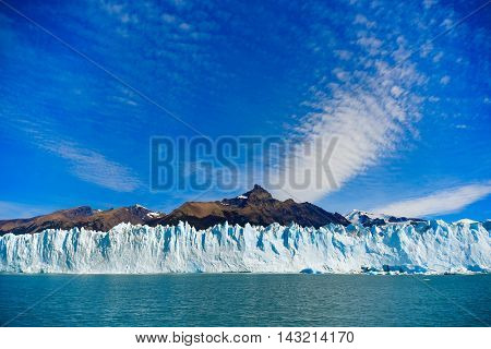 Los Glaciares National Park Argentina - Mar 21 2016: day view from the water at the Perito Moreno glacier in front of the mountain Cerro Moreno.