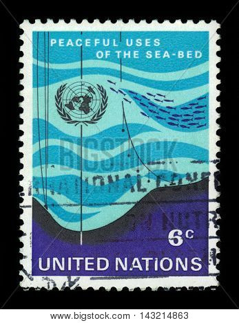 United Nations, Geneva - CIRCA 1971: a stamp printed in Geneva shows peaceful use of the sea bed, circa 1971