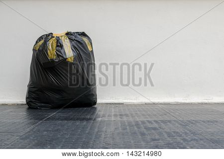 Black garbage bags put fully covered with adhesive tape.