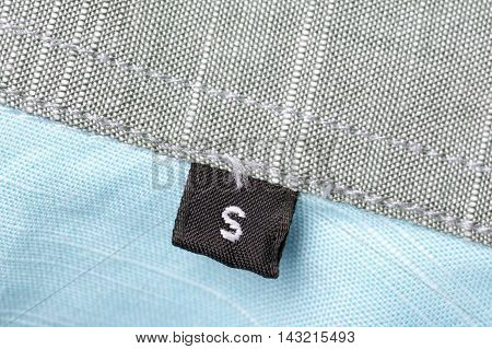 The tag size designation of clothes with the letter S