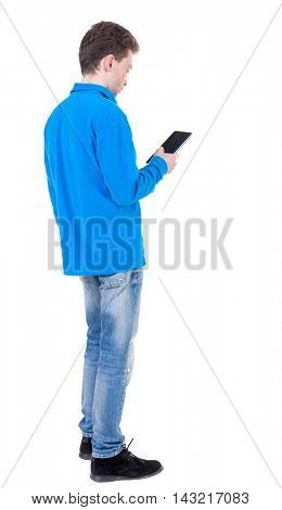 back view of business man uses mobile phone.    rear view people collection. Isolated over white background. backside view of person. Curly boy in blue jacket reading an e-book.