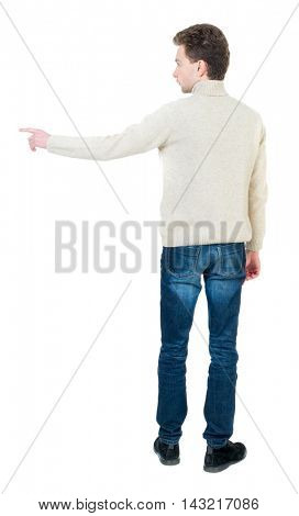 Back view of pointing business man.  Rear view people collection.  backside view of person.  Isolated over white background. Curly short-haired man in a woolen white jacket shows a finger in the side.