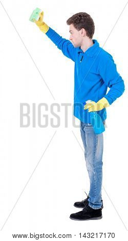 side view of a cleaner man in gloves with sponge and detergent. girl  watching.  view of person.  Isolated over white background. Curly boy in a warm blue sweater in the cleaning process.