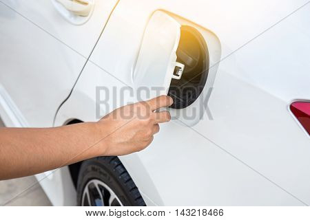 Hand opening the oil filler cap car