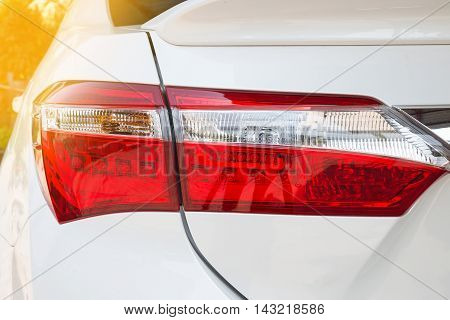 Closeup of a taillight on a modern white car