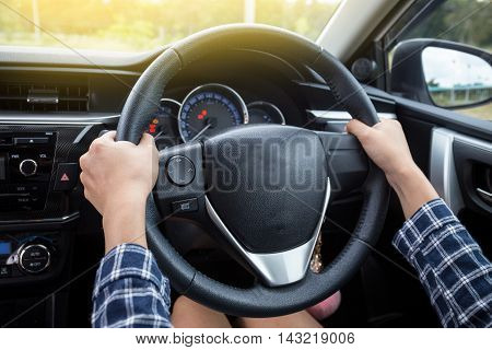 Close-up Of Woman's Hand Holding Steering Wheel for car driver