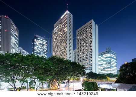 modern office buildings in tokyo at twilight