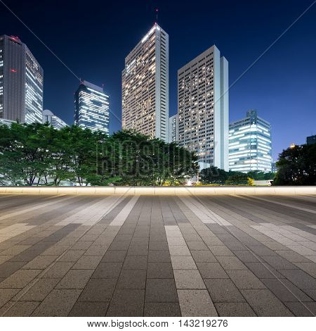 modern office buildings in tokyo at twilight from empty footpath
