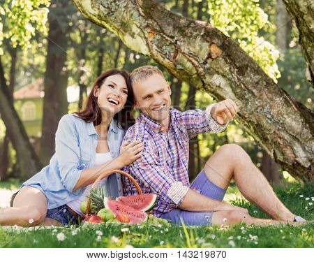 Cheerful, lovely couple being really happy together in the park.