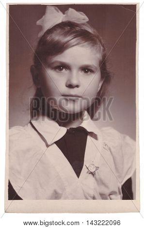 VITEBSK BELARUS - CIRCA 1954: Portrait of schoolgirl in spruced disciplic uniform (vintage toned photo 1954)