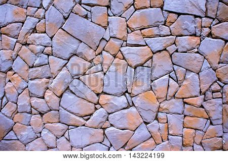 Beautiful stone wall texture in sunny day.