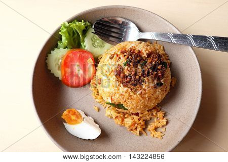Fried rice with catfish chili  on a table