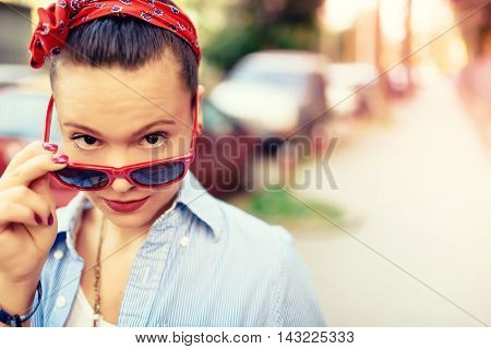 Beautiful Hipster Girl Wearing Sunglasses And Fashion Accessories. Smiling Girl Making Funny Faces I