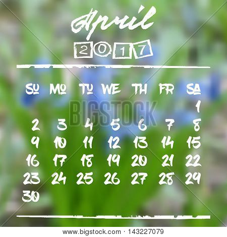Calendar design grid in hand written style with white lettering and dates of spring month April 2017 on natural blurred background. Blurry blue snowdrops. Vector illustration