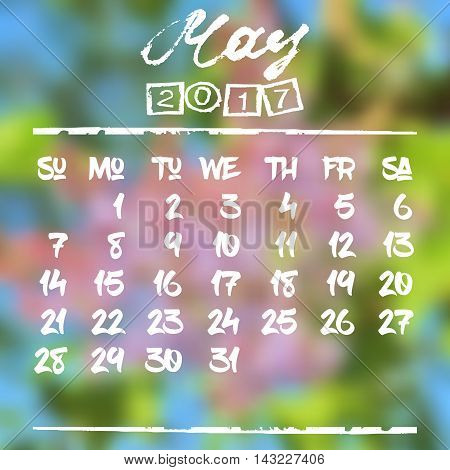 Calendar design grid in hand written style with white lettering and dates of spring month May 2017 on natural blurred background. Branch of lilac. Vector illustration